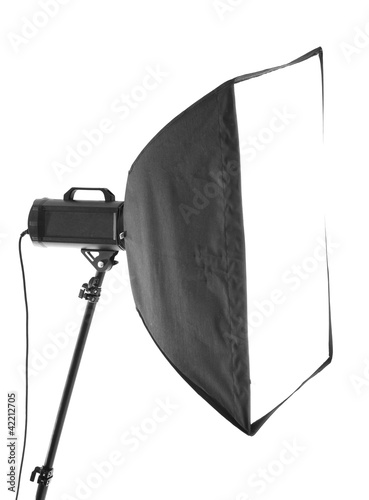 Studio flash with soft-box isolated on a white background