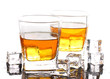 two glasses of scotch whiskey and ice on table isolated on