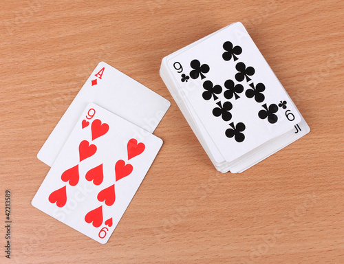 Cards on wooden background