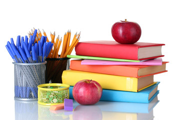 Composition of books, stationery and an apples isolated on