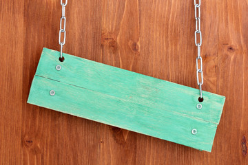 Color wooden sign board on wooden background