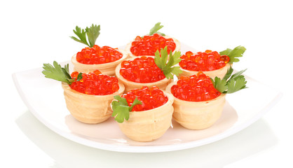 Red caviar in tartlets on white plate isolated on white