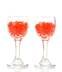 Red caviar in glasses isolated on white