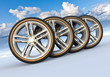 Set of car wheels in snowy landscape