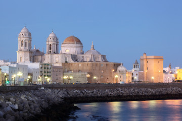 Cathedral in Cadiz illuminated at dusk, Spain