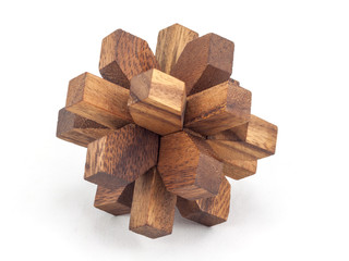 Puzzle of the wooden blocks on a white background