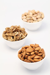 Bowls of Almond,pistachios and wall nuts isolated on white