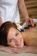 Lava stone massage woman at luxury spa