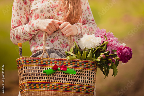 Stock Photo: Village girl with a basket in hand