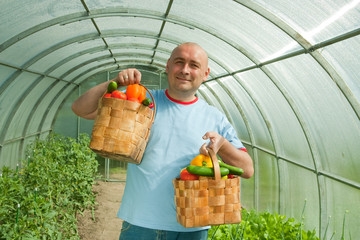 man with baskets with  vegetables
