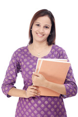 Happy Indian female student holding books