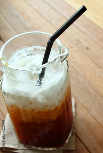 Cold coffee drink on table