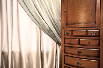 Chest of drawers and curtain