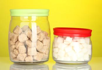 Jars with brown cane sugar lump and white lump sugar