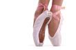 Closeup view of ballerina's feet on pointes