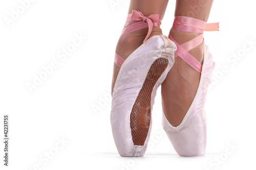 Closeup view of ballerina's feet on pointes