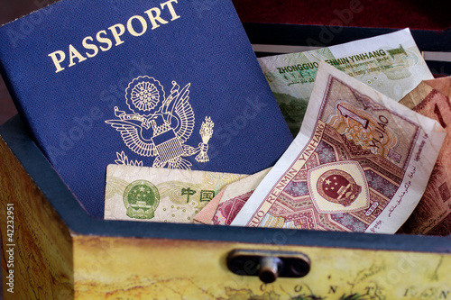 US passport with chinese currency in wood box