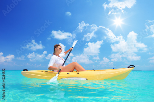 A female kayaking on a sunny day