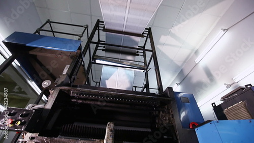 pan on newspaper production line in print shop factory