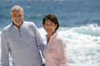 Elderly couple enjoying stroll on the beach