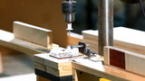 Drilling a plywood at wood factory close-up poster