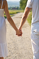 Couple holds hands