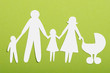 Closeup of paper family on green background
