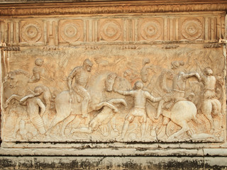 Alhambra, wall of Carlos V Palace. Relief carving of a battle sc