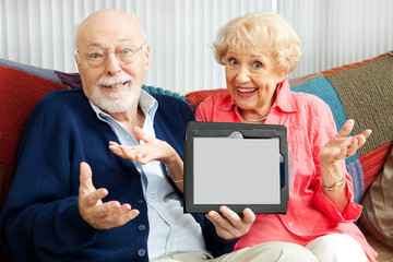 Senior Couple Confused by Tablet PC