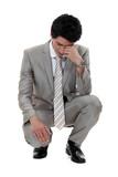 A sad businessman.