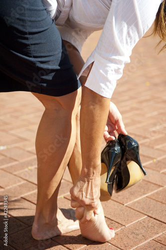 Woman in pain from wearing high heels