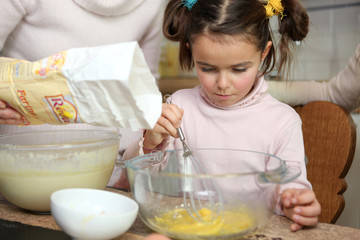 Young girl learning how to cook