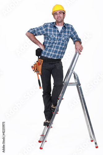 An handyman on a ladder.