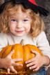 Child with big pumpkin