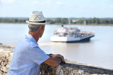 Tourist watching a ferry
