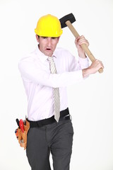 Angry engineer waving a mallet around