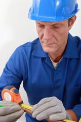 Man measuring copper tube