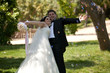 bride and groom at a park 2
