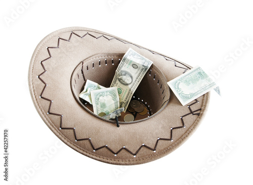 Money in a cowboy hat. Alms