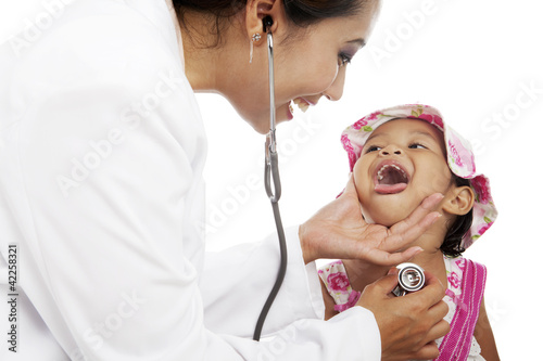 Femal doctor examining child