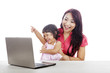 Happy mother and daughter with laptop