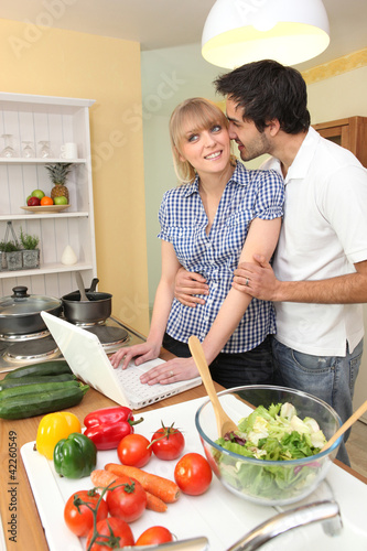 Couple following on-line recipe