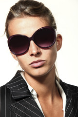 woman and sunglasses, serious person