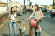 Two Girls While they make shopping in bicycle to Pisa