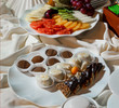 Assortment of fresh fruits and chocolate candies on a table