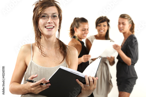 Four young businesswomen on white background