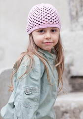 Little girl in knit pink hat