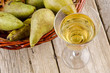 fruit wine in a glass and fresh pears