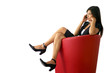 Brunette sat in designer leather chair