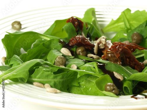 Arugula, tomatoes, capers: salad